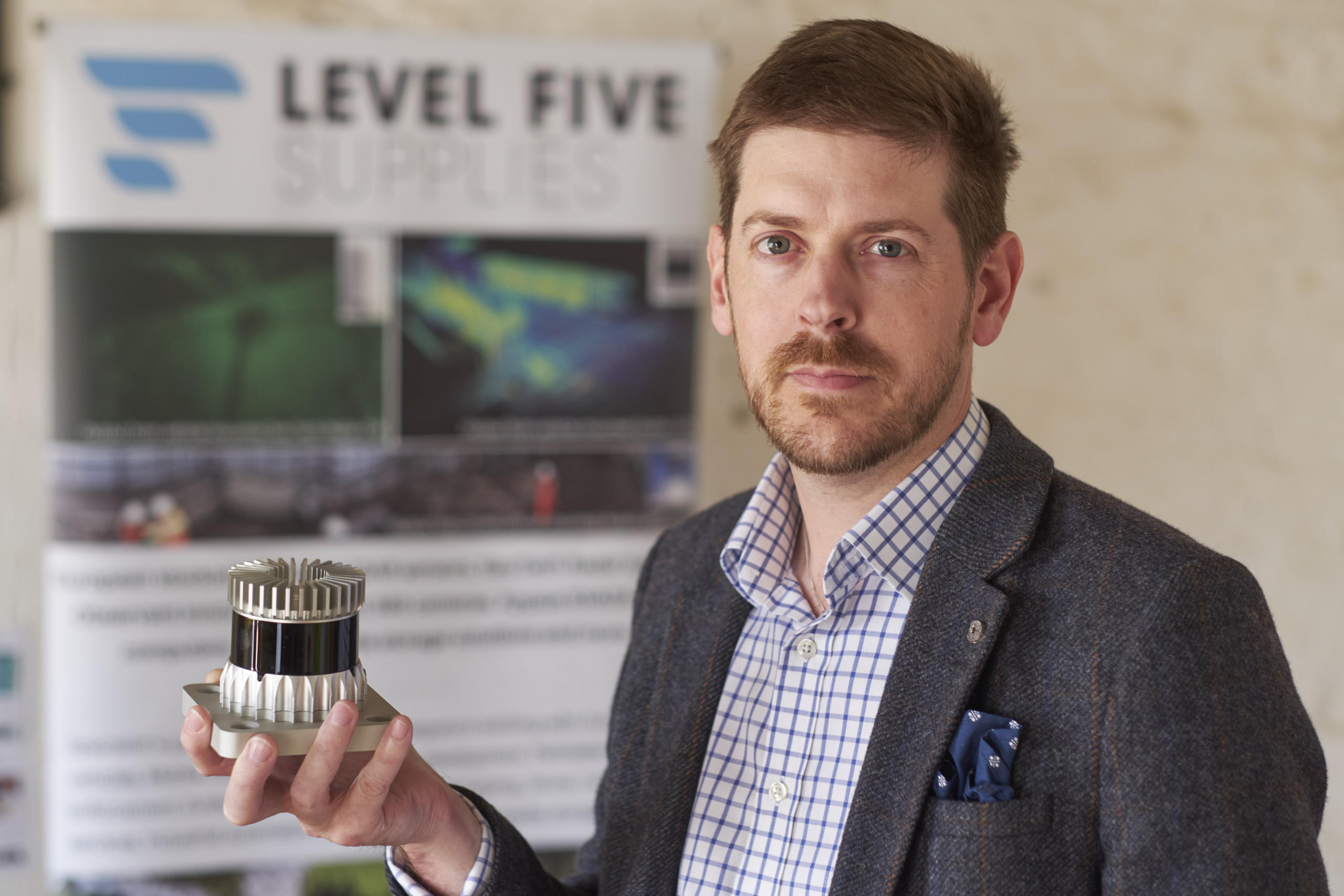 Alex Lawrence Berkeley CEO Level Five Supplies holding an Ouster LiDAR unit